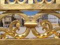 Peeking through gate at Versailles in Paris
